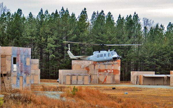 A photo showing a Navy test flight of an unmanned helicopter