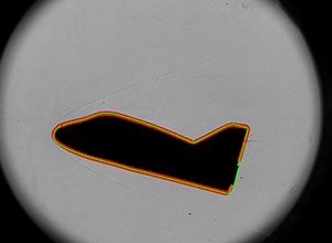 A silhouette image of a free-flying object inside a hypersonic wind tunnel